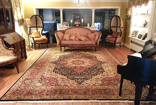 Well-balanced, stylishly appointed room with Nejad rug as centerpiece