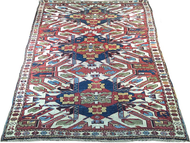 This Antique Kazak Carpet