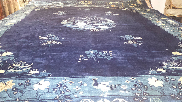 water-damaged antique oriental carpet (pictured)