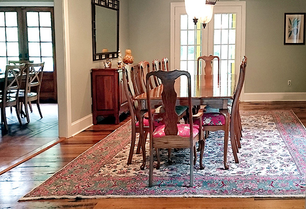 Antique carpet in elegant dining room setting