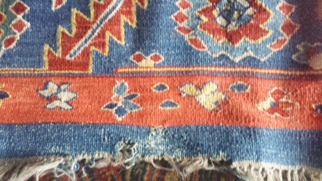 Moth-damaged semi-antique rug