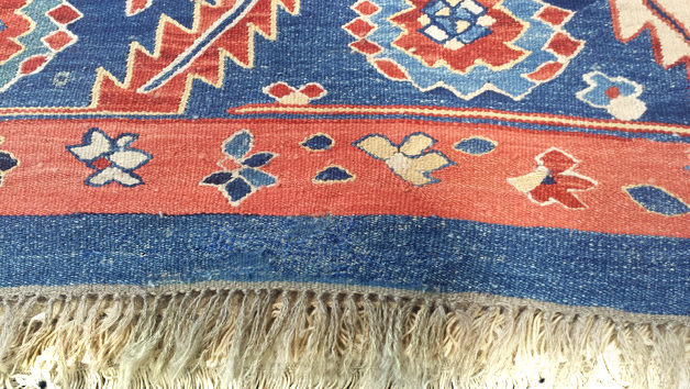 Semi antique Kilim rug after repair