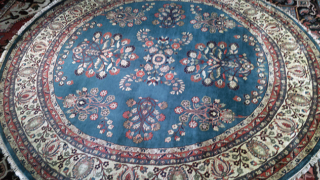 Blue round Oriental rug with a Persian Sarough design (pictured)