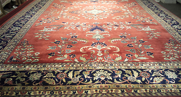 An elegant hand-knotted Persian Sarough rug from Nejad (pictured)