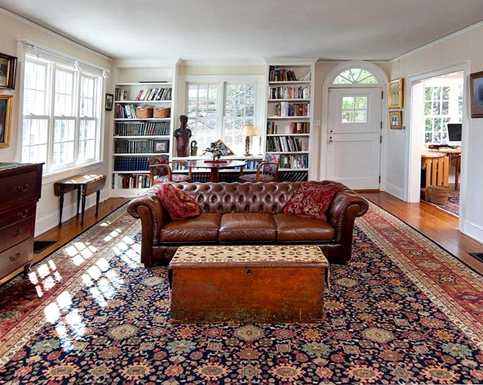 Room size Nejad Mahal rug as focal point in large, spacious living room